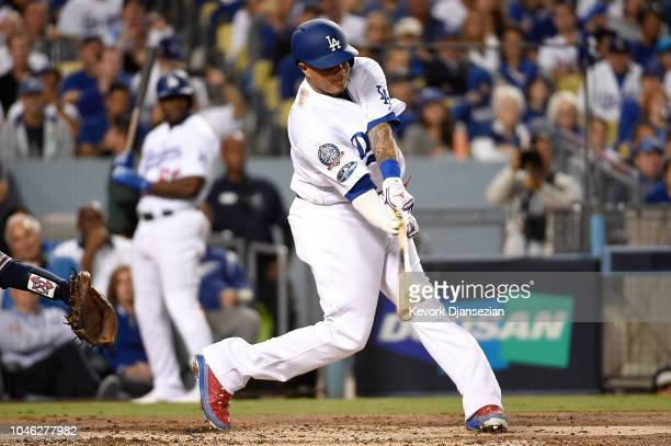 Manny Machado of the Los Angeles Dodgers hits a two run home run in the first inning against the Atlanta Braves during Game Two of the National...