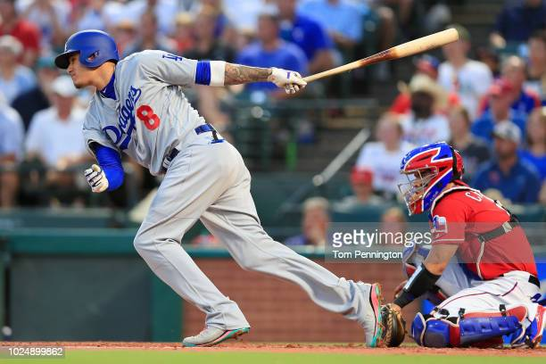 Manny Machado of the Los Angeles Dodgers hits a twoRBI single against the Texas Rangers in the top of the third inning at Globe Life Park in...