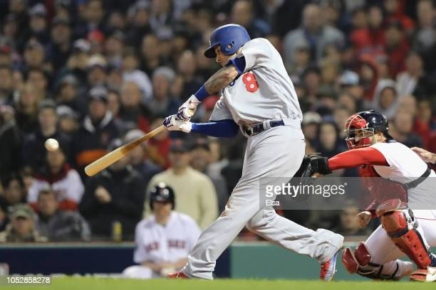 Manny Machado of the Los Angeles Dodgers hits into an RBI fielders choice during the fifth inning against the Boston Red Sox in Game One of the 2018...