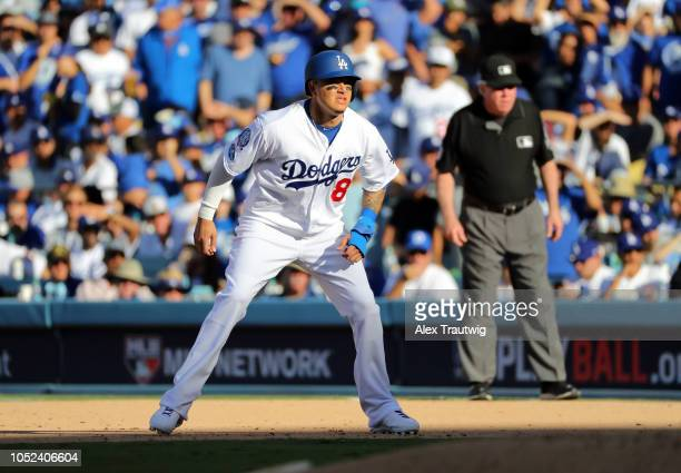 Manny Machado of the Los Angeles Dodgers leads off first base in the sixth inning of Game 5 of the NLCS against the Milwaukee Brewers at Dodger...