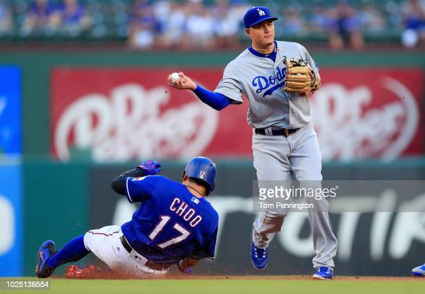 Manny Machado of the Los Angeles Dodgers makes the out against ShinSoo Choo of the Texas Rangers in the bottom of the first inning at Globe Life Park...