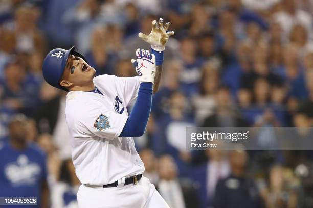 Manny Machado of the Los Angeles Dodgers reacts after flying out during the tenth inning against the Boston Red Sox in Game Three of the 2018 World...
