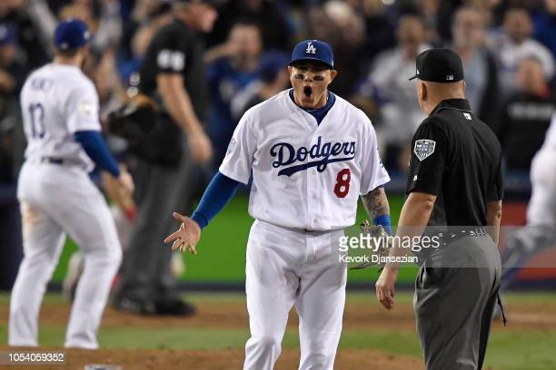 Manny Machado of the Los Angeles Dodgers reacts during the tenth inning against the Boston Red Sox in Game Three of the 2018 World Series at Dodger...