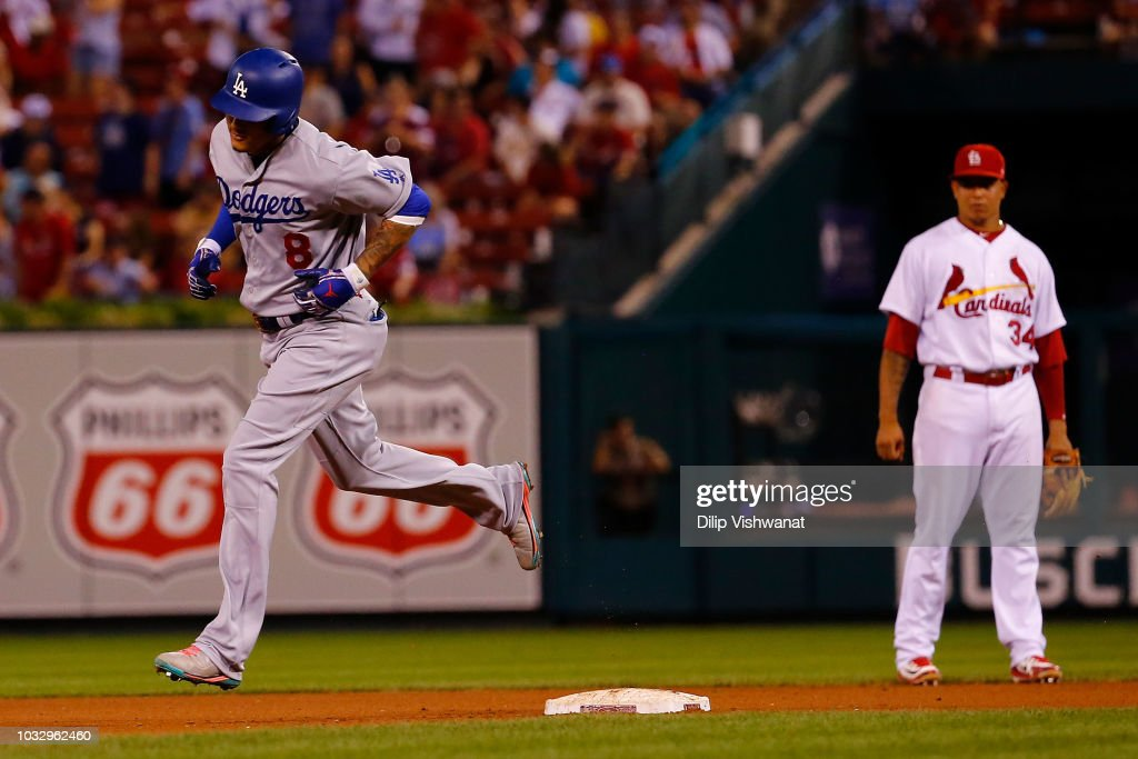 Manny Machado #8 of the Los Angeles Dodgers rounds second base after hitting a home run against the St. Louis Cardinals in the seventh inning at Busch Stadium on September 13, 2018 in St. Louis, Missouri.