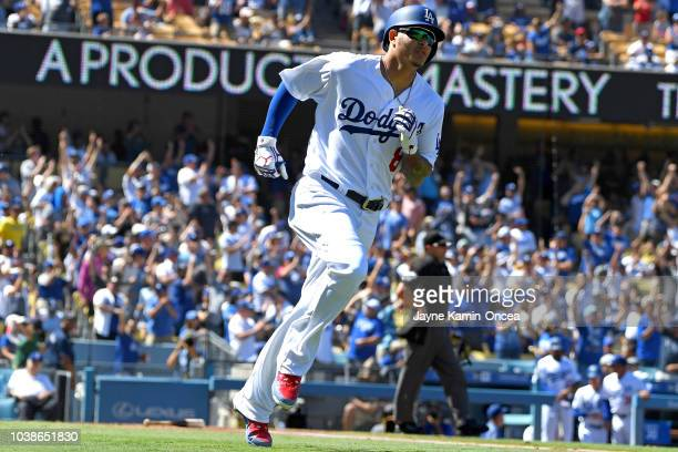 Manny Machado of the Los Angeles Dodgers rounds the bases after hitting a solo home run in the second inning of the game against the San Diego Padres...
