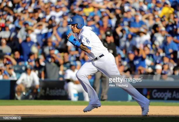 Manny Machado of the Los Angeles Dodgers runs to second in the sixth inning of Game 5 of the NLCS against the Milwaukee Brewers at Dodger Stadium on...
