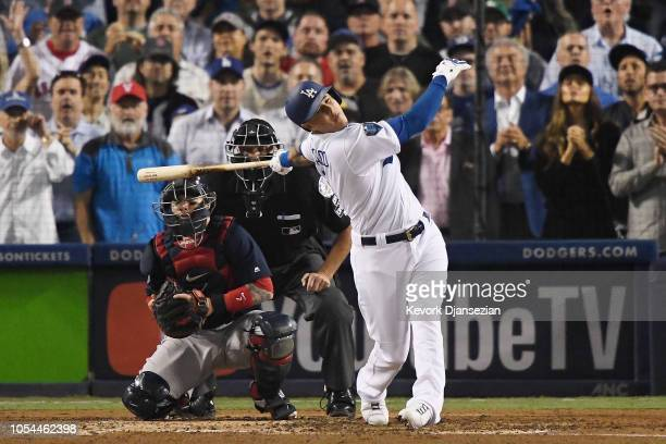 Manny Machado of the Los Angeles Dodgers strikes out swinging and hits catcher's Christian Vazquez of the Boston Red Sox helmet in the fourth inning...