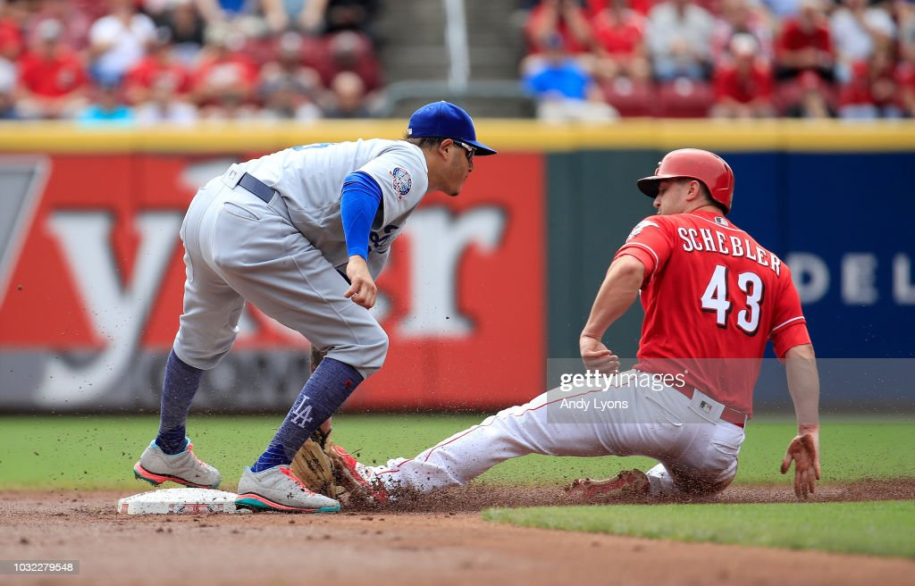 Manny Machado #8 of the Los Angeles Dodgers tags out Scott Schebler #43 of the Cincinnati Reds as he attempted to steal second base in the first inning at Great American Ball Park on September 12, 2018 in Cincinnati, Ohio.