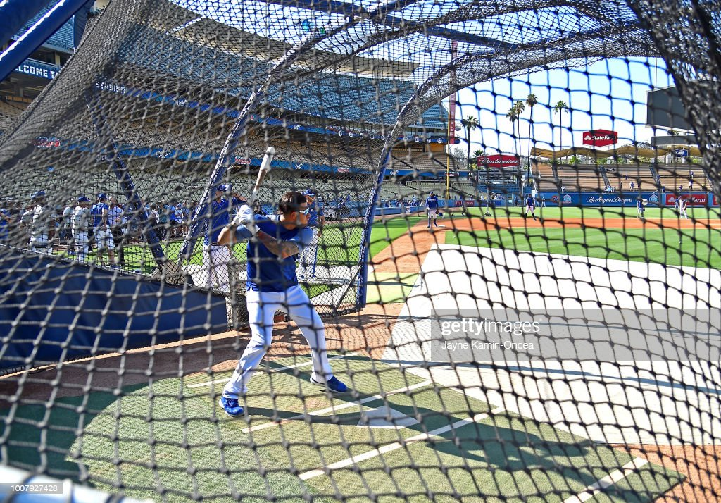 Manny Machado #8 of the Los Angeles Dodgers takes batting practice before the game against the Milwaukee Brewers at Dodger Stadium on July 30, 2018 in Los Angeles, California.