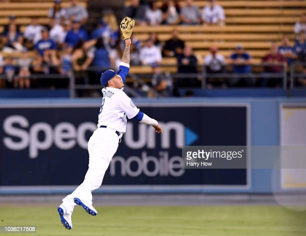 Manny Machado of the Los Angeles Dodgers watches a Charlie Blackmon of the Colorado Rockies single during the first inning at Dodger Stadium on...