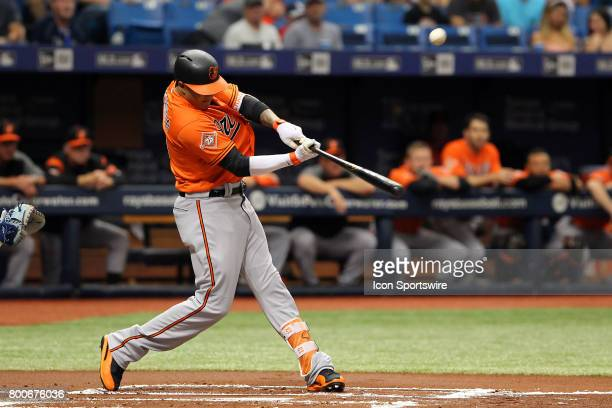 Manny Machado of the Orioles hits a long fly ball during the MLB regular season game between the Baltimore Orioles and Tampa Bay Rays on June 24 at...