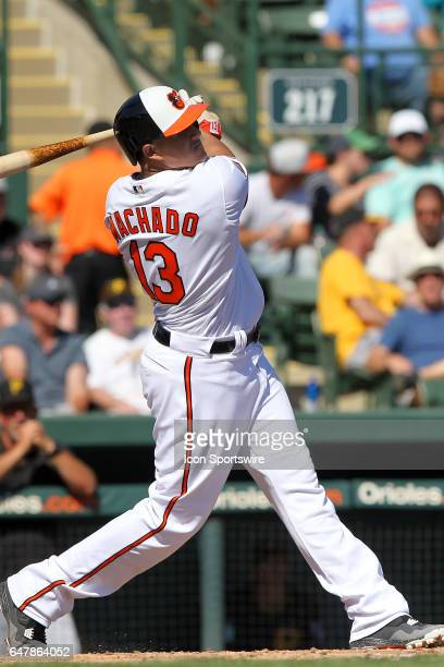 Manny Machado of the Orioles takes this pitch the opposite way for a home run during the spring training game between the Pittsburgh Pirates and the...