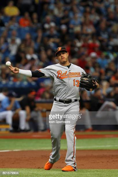 Manny Machado of the Orioles throws the ball over from third base to first base for the out during the MLB regular season game between the Baltimore...