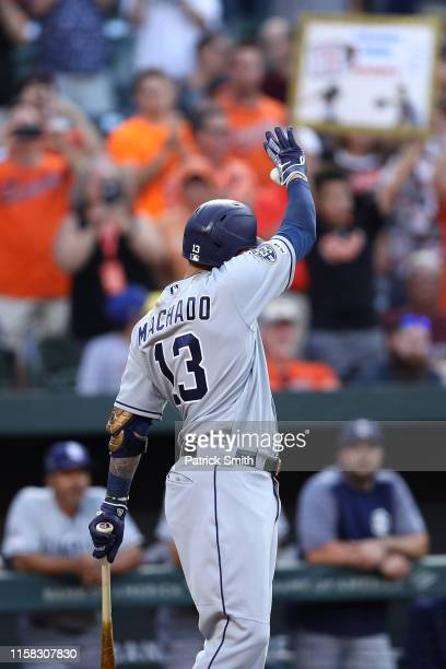 Manny Machado of the San Diego Padres acknowledges the crowd before batting during the first inning against the Baltimore Orioles at Oriole Park at...