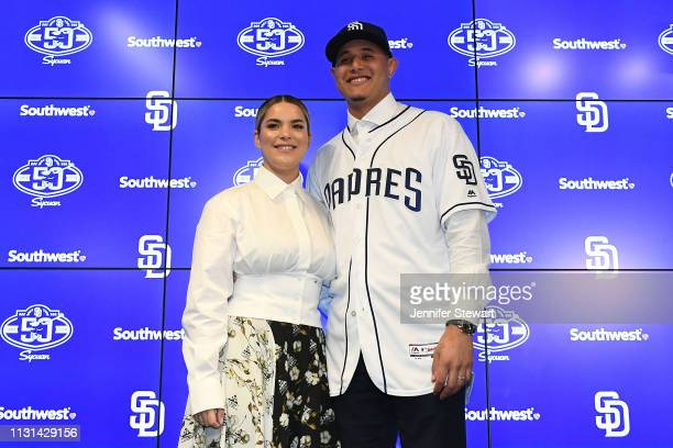 Manny Machado of the San Diego Padres and his wife Yainee Alonso smile for a photo at Peoria Stadium on February 22, 2019 in Peoria, Arizona.