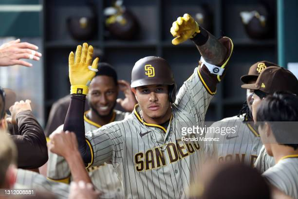 Manny Machado of the San Diego Padres celebrates a homerun against the Texas Rangers in the ninth inning at Globe Life Field on April 11, 2021 in...