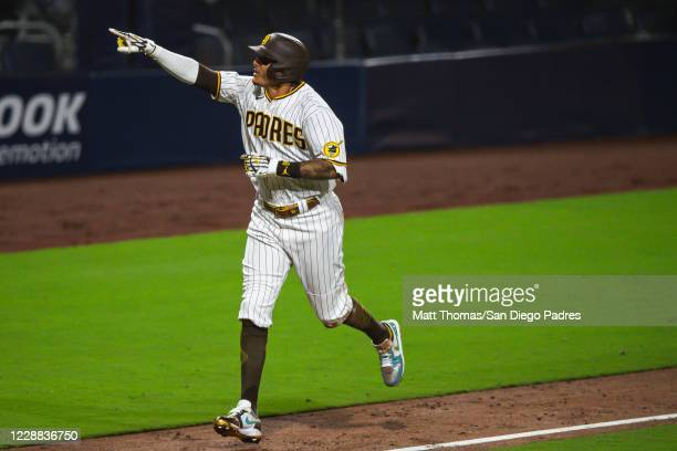 Manny Machado of the San Diego Padres celebrates after hitting a home run in the bottom of the sixth inning against the St Louis Cardinals during...