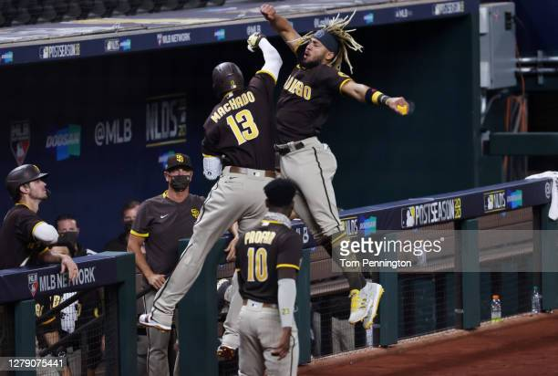 Manny Machado of the San Diego Padres celebrates with Fernando Tatis Jr. #23 after hitting a solo home run during the sixth inning against the Los...