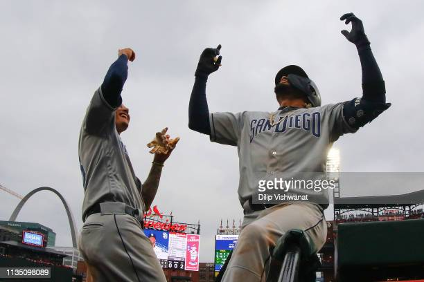 Manny Machado of the San Diego Padres congratulates Fernando Tatis Jr #23 of the San Diego Padres after Tatis Jr hits tworun home run against the St...