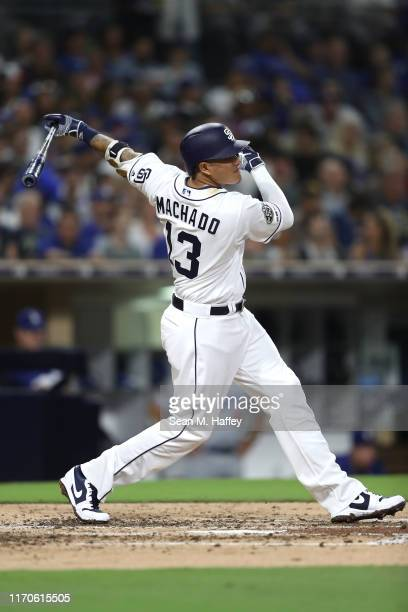 Manny Machado of the San Diego Padres connects for a double during the fourth inning of a game against the Los Angeles Dodgersat PETCO Park on August...
