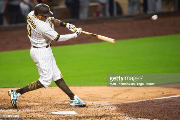 Manny Machado of the San Diego Padres hits a home run in the bottom of the sixth inning against the St Louis Cardinals during Game Two of the...