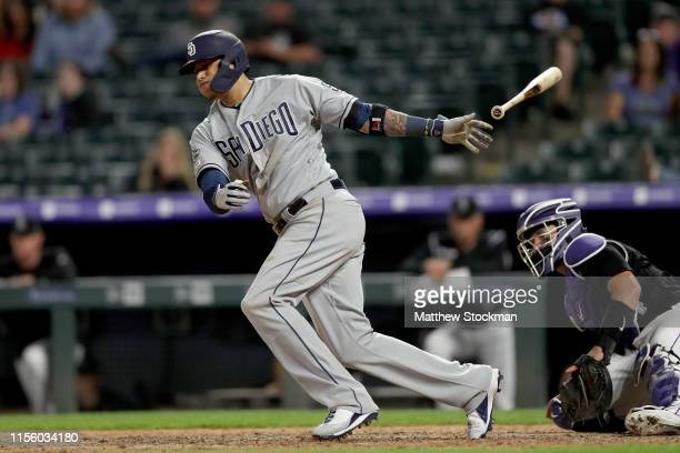Manny Machado of the San Diego Padres hits a RBI double in the 12th inning against the Colorado Rockies at Coors Field on June 14 2019 in Denver...