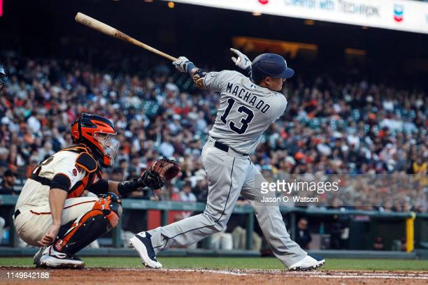 Manny Machado of the San Diego Padres hits a single against the San Francisco Giants during the third inning at Oracle Park on June 12 2019 in San...