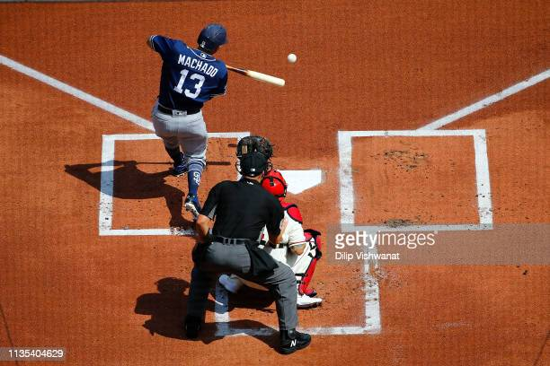 Manny Machado of the San Diego Padres hits a single against the St Louis Cardinals in the first inning at Busch Stadium on April 6 2019 in St Louis...