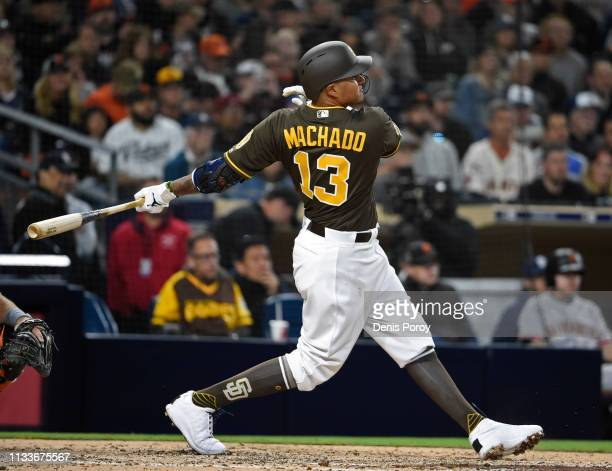 Manny Machado of the San Diego Padres hits a single during the fifth inning against the San Francisco Giants at Petco Park March 29 2019 in San Diego...