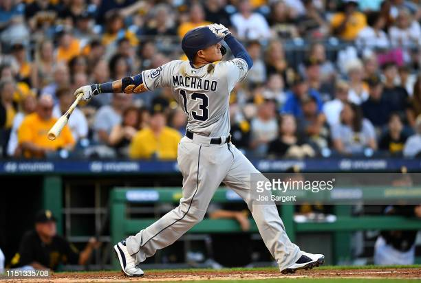 Manny Machado of the San Diego Padres hits a solo home run during the fourth inning against the Pittsburgh Pirates at PNC Park on June 21 2019 in...