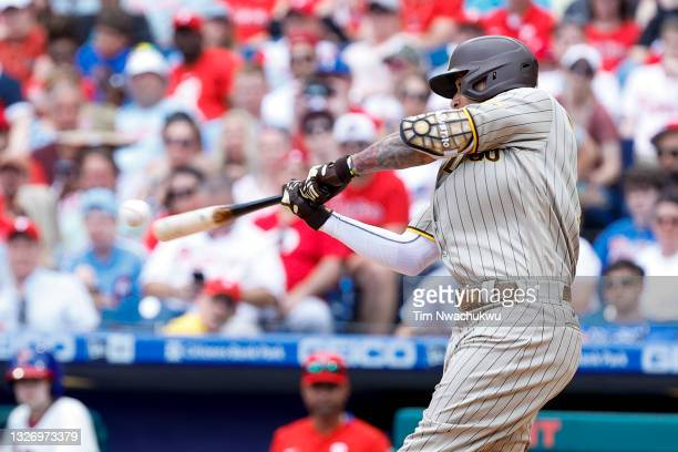 Manny Machado of the San Diego Padres hits a three-run home run during the third inning against the Philadelphia Phillies at Citizens Bank Park on...