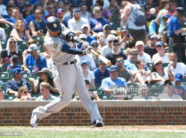 Manny Machado of the San Diego Padres hits a two-run home run against the Chicago Cubsduring the third inning at Wrigley Field on July 20, 2019 in...