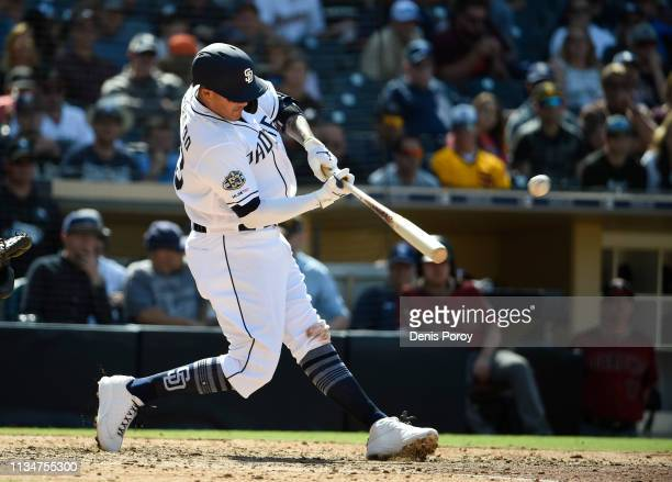 Manny Machado of the San Diego Padres hits a tworun home run during the seventh inning of a baseball game against the Arizona Diamondbacks at Petco...