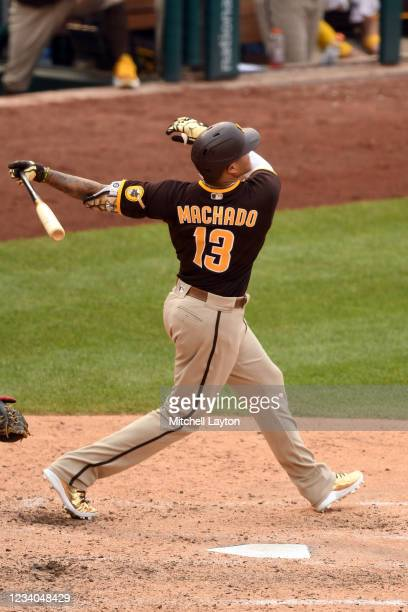 Manny Machado of the San Diego Padres hits a two-run home run in the eighth inning during a baseball game against the Washington Nationals at...