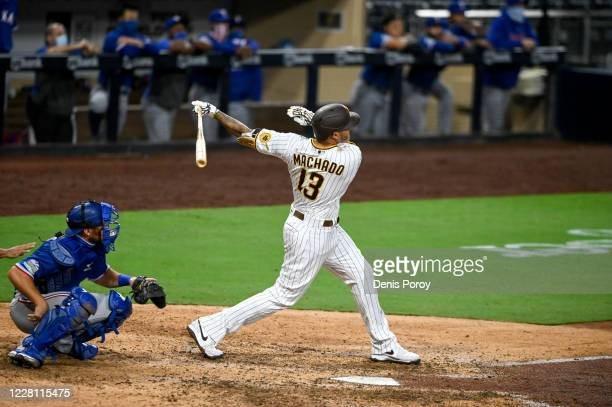 Manny Machado of the San Diego Padres hits a walk-off grand slam in the 10th inning against the Texas Rangers at Petco Park on August 19, 2020 in San...