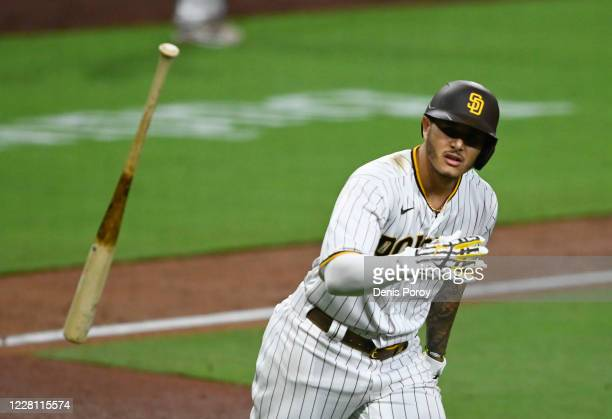 Manny Machado of the San Diego Padres hits a walk-off grand slam during the 10th inning of a baseball game against the Texas Rangers at Petco Park on...