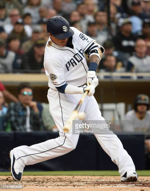 Manny Machado of the San Diego Padres hits an RBI single during the third inning of a baseball game against the Pittsburgh Pirates at Petco Park May...