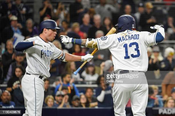 Manny Machado of the San Diego Padres is congratulated by Hunter Renfroe after hitting a solo home run during the third inning of a baseball game...