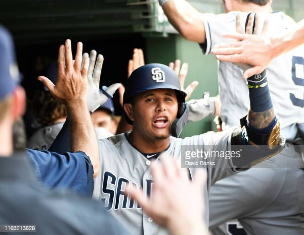 Manny Machado of the San Diego Padres is greeted in the dugout after hitting a two-run home run against the Chicago Cubs during the third inning at...