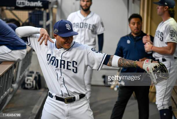 Manny Machado of the San Diego Padres plays around in the dugout before a baseball game against the Arizona Diamondbacks at Petco Park April 2 2019...