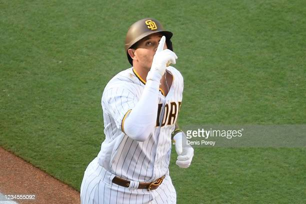 Manny Machado of the San Diego Padres points skyward after hitting a solo home run during the first inning of a baseball game against the Arizona...