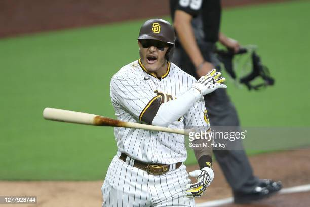 Manny Machado of the San Diego Padres reacts after hitting a solo homerun during the sixth inning of Game Two of the National League Wild Card Series...