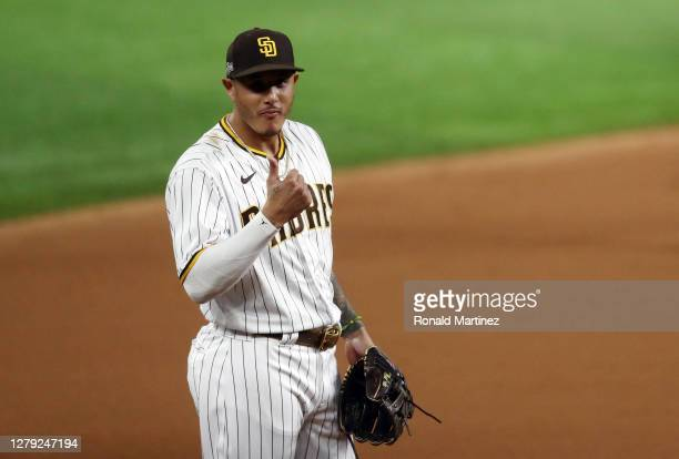 Manny Machado of the San Diego Padres reacts during the second inning against the Los Angeles Dodgers in Game Three of the National League Division...