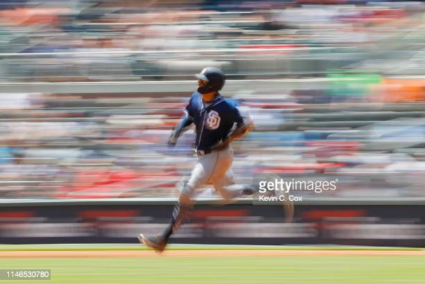 Manny Machado of the San Diego Padres rounds first base after hitting a RBI double in the sixth inning against the Atlanta Braves at SunTrust Park on...