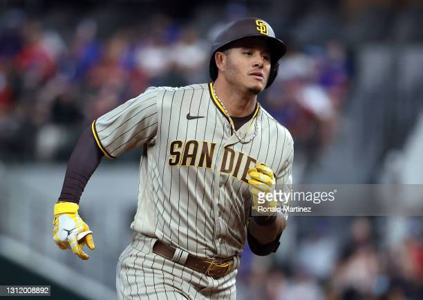 Manny Machado of the San Diego Padres runs after hitting a homerun against the Texas Rangers in the ninth inning at Globe Life Field on April 11,...