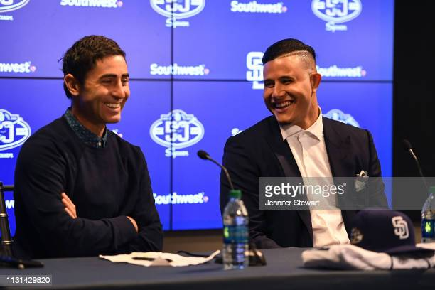 Manny Machado of the San Diego Padres shares a laugh alongside side Executive V.P./General Manager A.J. Preller at Peoria Stadium on February 22,...
