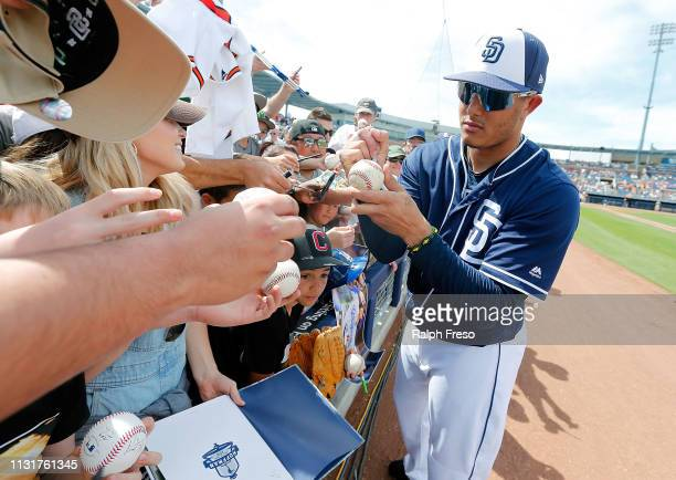 Manny Machado of the San Diego Padres signs autographs for fans prior to an MLB spring training game against the Milwaukee Brewers at Peoria Stadium...