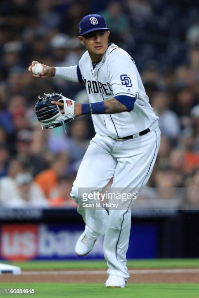 Manny Machado of the San Diego Padres throws out Buster Posey of the San Francisco Giants during the fourth inning of a game at PETCO Park on July 01...