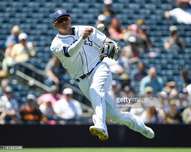 Manny Machado of the San Diego Padres throws out Tommy Pham of the Tampa Bay Rays during the third inning of a baseball game at Petco Park August 14...