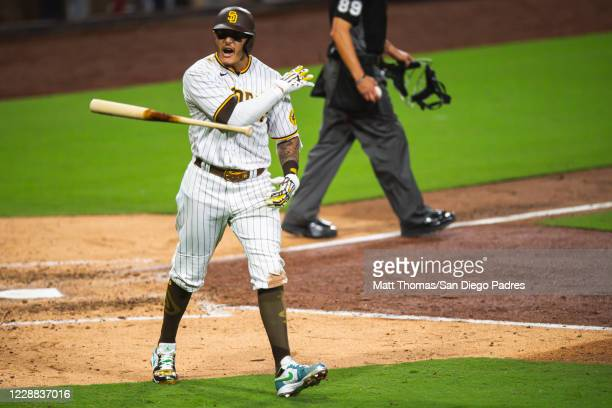 Manny Machado of the San Diego Padres tosses his bat after hitting a home run in the bottom of the sixth inning against the St Louis Cardinals during...